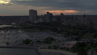 DX0002_155_027 - 5.7K stock footage aerial video of skyscrapers in the city's skyline seen while passing the marina at twilight, Downtown Milwaukee, Wisconsin