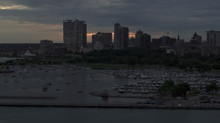 DX0002_155_029 - 5.7K stock footage aerial video of ascending by the marina with a view of the city's skyline at twilight, Downtown Milwaukee, Wisconsin