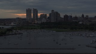 DX0002_155_030 - 5.7K stock footage aerial video of flying past the marina with a view of the city's skyline at twilight, Downtown Milwaukee, Wisconsin