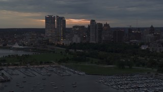 DX0002_155_032 - 5.7K stock footage aerial video a stationary view of the city's skyline at twilight from over the marina, Downtown Milwaukee, Wisconsin