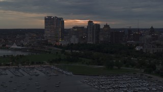 DX0002_155_033 - 5.7K stock footage aerial video flyby and away from the city's skyline at twilight, Downtown Milwaukee, Wisconsin