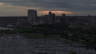 DX0002_155_034 - 5.7K stock footage aerial video pass and fly away from the city's skyline at twilight, Downtown Milwaukee, Wisconsin