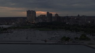 DX0002_155_036 - 5.7K stock footage aerial video slowly flyby marina and the city's skyline at twilight, Downtown Milwaukee, Wisconsin