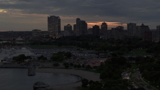 DX0002_155_037 - 5.7K stock footage aerial video descend near marina and the city's skyline at twilight, Downtown Milwaukee, Wisconsin