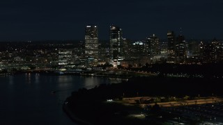 DX0002_155_039 - 5.7K stock footage aerial video of a view of the city's skyline from the marina at night, Downtown Milwaukee, Wisconsin