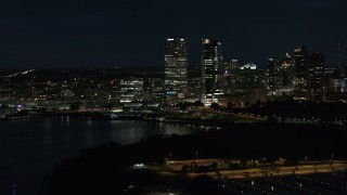 DX0002_155_042 - 5.7K stock footage aerial video fly over marina with a view of the city's skyline at night, Downtown Milwaukee, Wisconsin