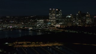 DX0002_155_043 - 5.7K stock footage aerial video fly above the marina while focused on the city's skyline at night, Downtown Milwaukee, Wisconsin