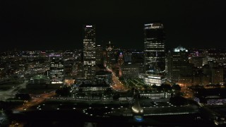 DX0002_157_002 - 5.7K stock footage aerial video of flying by tall skyscrapers at night, Downtown Milwaukee, Wisconsin