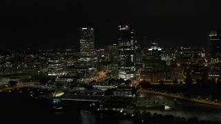 DX0002_157_003 - 5.7K stock footage aerial video of passing by tall skyscrapers at night, Downtown Milwaukee, Wisconsin