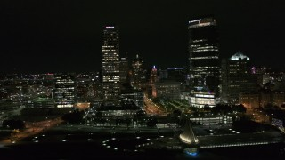 DX0002_157_005 - 5.7K stock footage aerial video flyby towering skyscrapers at night, Downtown Milwaukee, Wisconsin