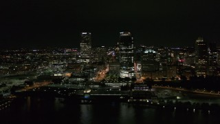 DX0002_157_007 - 5.7K stock footage aerial video of towering skyscrapers near the shoreline at night, Downtown Milwaukee, Wisconsin