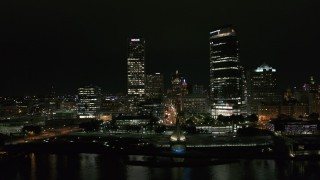 DX0002_157_008 - 5.7K stock footage aerial video approach and flyby towering skyscrapers at night, Downtown Milwaukee, Wisconsin