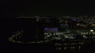 DX0002_157_011 - 5.7K stock footage aerial video fly away from Discovery World museum at night, Downtown Milwaukee, Wisconsin