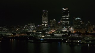 DX0002_157_013 - 5.7K stock footage aerial video orbiting museum and skyscrapers at night, Downtown Milwaukee, Wisconsin