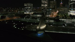 DX0002_157_019 - 5.7K stock footage aerial video circling the lakefront museum at night before flying away, Downtown Milwaukee, Wisconsin