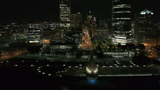 DX0002_157_022 - 5.7K stock footage aerial video ascend over museum for view of Wisconsin Ave at night, Downtown Milwaukee, Wisconsin
