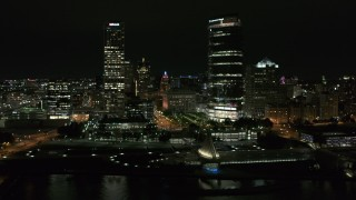 DX0002_157_024 - 5.7K stock footage aerial video stationary view of the lakefront museum and skyscrapers at night, Downtown Milwaukee, Wisconsin