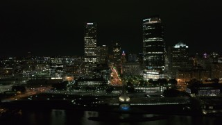 DX0002_157_026 - 5.7K stock footage aerial video of two skyscrapers and lakefront museum at night, Downtown Milwaukee, Wisconsin