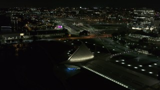 DX0002_157_027 - 5.7K stock footage aerial video orbit lakefront museum rooftop at night, Downtown Milwaukee, Wisconsin