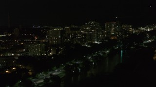 DX0002_157_030 - 5.7K stock footage aerial video of passing a row of apartment buildings at night, Milwaukee, Wisconsin