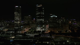 DX0002_157_033 - 5.7K stock footage aerial video of a wide orbit of a tall skyscraper at night, Downtown Milwaukee, Wisconsin