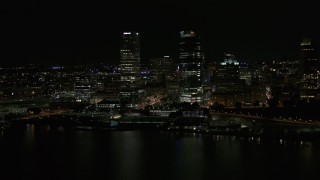DX0002_157_039 - 5.7K stock footage aerial video a pair of towering skyscrapers seen from the lake at night, Downtown Milwaukee, Wisconsin