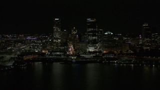 DX0002_157_040 - 5.7K stock footage aerial video of towering skyscrapers seen from the lake at night, Downtown Milwaukee, Wisconsin