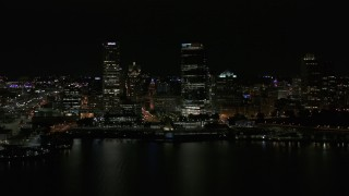 DX0002_157_041 - 5.7K stock footage aerial video view of towering skyscrapers seen from the lake at night, Downtown Milwaukee, Wisconsin