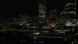 DX0002_157_045 - 5.7K stock footage aerial video orbit museum near skyscrapers at night, Downtown Milwaukee, Wisconsin