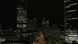 DX0002_157_053 - 5.7K stock footage aerial video fly over museum near skyscrapers, reveal city street at night, Downtown Milwaukee, Wisconsin
