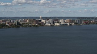 DX0002_158_004 - 5.7K stock footage aerial video slowly approach lakefront city buildings in Madison, Wisconsin