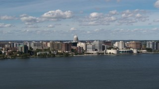 DX0002_158_005 - 5.7K stock footage aerial video slowly fly away from lakefront city buildings in Madison, Wisconsin