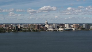 DX0002_158_006 - 5.7K stock footage aerial video slowly flying by lakefront city buildings in Madison, Wisconsin