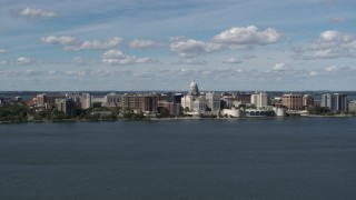 DX0002_158_007 - 5.7K stock footage aerial video a reverse view of lakefront city buildings in Madison, Wisconsin
