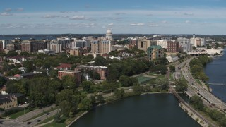 DX0002_158_013 - 5.7K stock footage aerial video flyby and away from apartment complexes near capitol dome in Madison, Wisconsin
