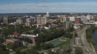 DX0002_158_017 - 5.7K stock footage aerial video reverse view of apartment complexes near the capitol dome in Madison, Wisconsin