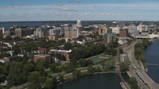 DX0002_158_018 - 5.7K stock footage aerial video of passing apartment complexes around the capitol dome in Madison, Wisconsin