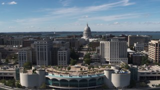 DX0002_158_025 - 5.7K stock footage aerial video of the capitol dome and office buildings, reveal convention center, Madison, Wisconsin