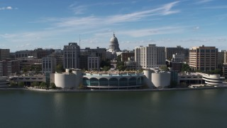DX0002_158_026 - 5.7K stock footage aerial video reverse view of capitol dome, office buildings, and convention center, Madison, Wisconsin