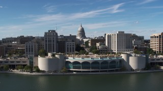 DX0002_158_027 - 5.7K stock footage aerial video approach capitol dome, office buildings, and convention center, Madison, Wisconsin