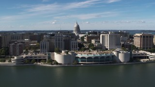 DX0002_158_031 - 5.7K stock footage aerial video fly away from convention center with view of capitol dome, office buildings, Madison, Wisconsin