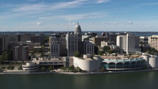 DX0002_158_032 - 5.7K stock footage aerial video flyby the convention center with view of capitol dome, office buildings, Madison, Wisconsin