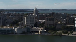 DX0002_160_004 - 5.7K stock footage aerial video of the capitol seen from lakefront office buildings, Madison, Wisconsin
