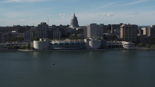 DX0002_160_007 - 5.7K stock footage aerial video flyby convention center with capitol and office buildings in background, Madison, Wisconsin
