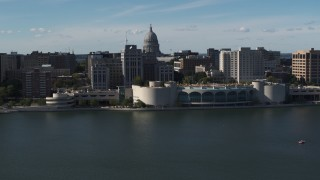DX0002_160_008 - 5.7K stock footage aerial video flyby and approach convention center with capitol and office buildings in background, Madison, Wisconsin