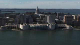 DX0002_160_009 - 5.7K stock footage aerial video ascending away from convention center with capitol and office buildings in background, Madison, Wisconsin
