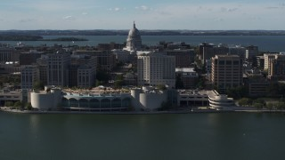 DX0002_160_010 - 5.7K stock footage aerial video of passing the convention center with capitol and office buildings in background, Madison, Wisconsin