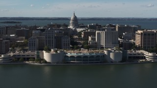 DX0002_160_012 - 5.7K stock footage aerial video of slowly passing the convention center with capitol and office buildings in background, Madison, Wisconsin