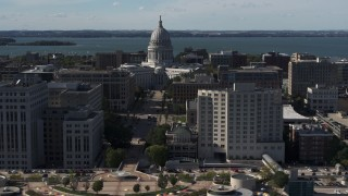 DX0002_160_013 - 5.7K stock footage aerial video approach the convention center, focus on capitol behind office buildings, Madison, Wisconsin