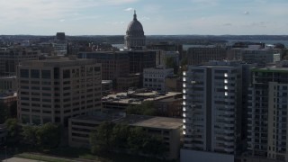 DX0002_160_015 - 5.7K stock footage aerial video focus on capitol and pass by office buildings, Madison, Wisconsin